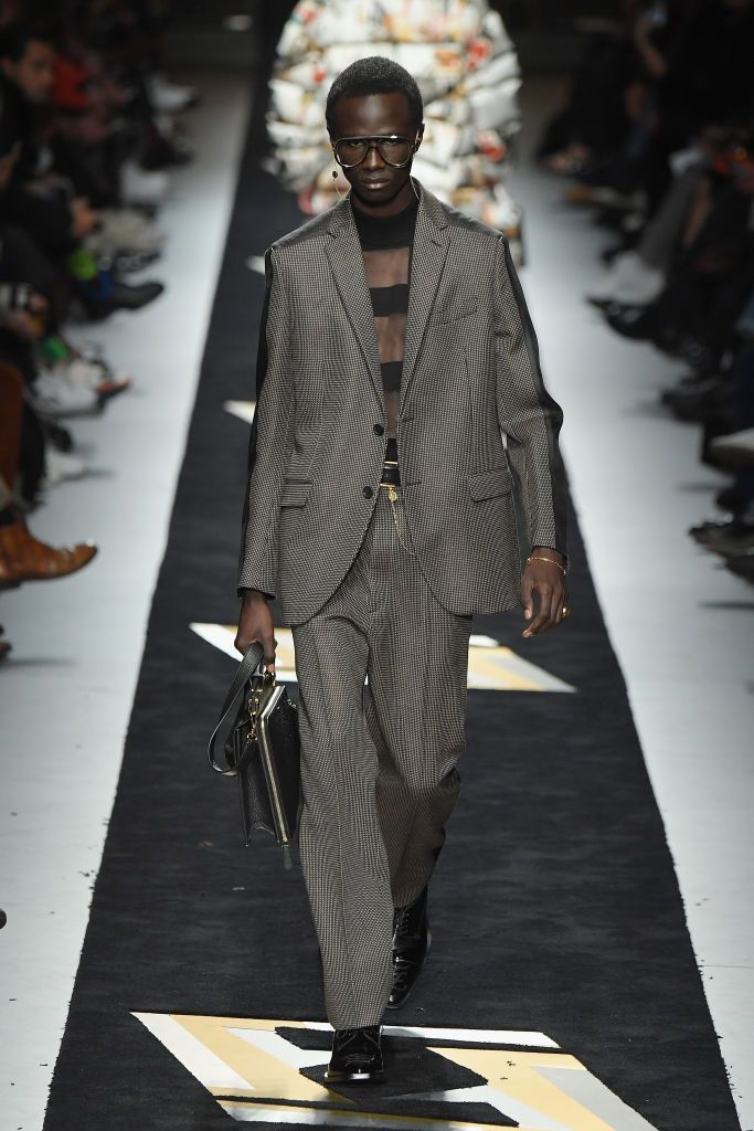 cde72dbbbbd A model walks the runway at the Fendi show during Milan Menswear ...