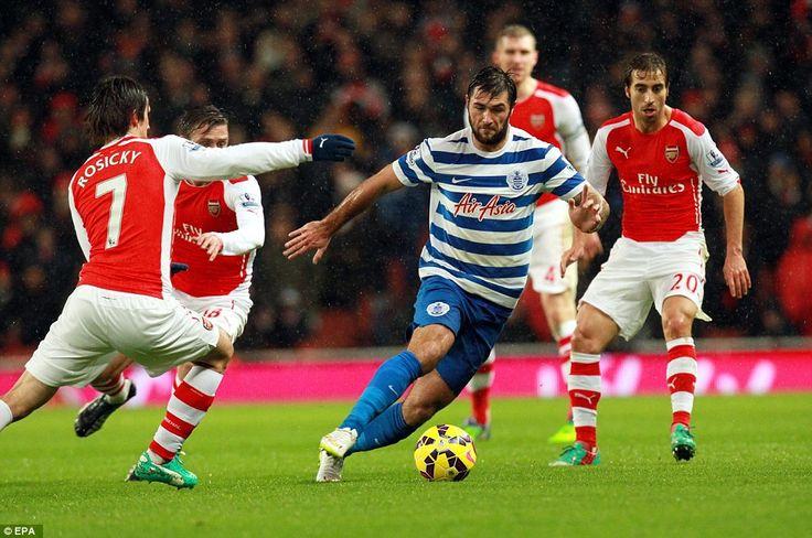 QPR striker Charlie Austin (centre) tries to dribble past Rosicky (left) as Rangers' were ...