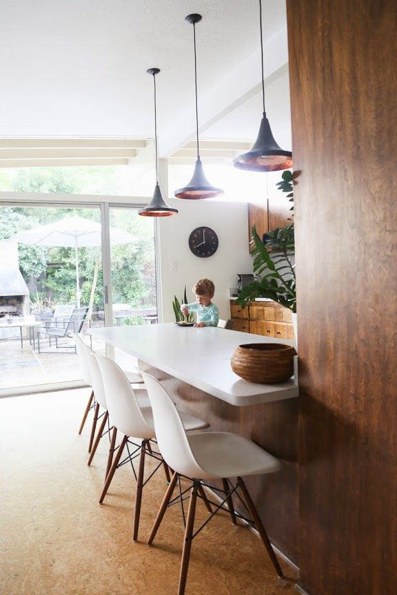 Pretty wood cabinets...and I love the big sliding glass doors letting in all of the light! A CUP OF JO: California house tour
