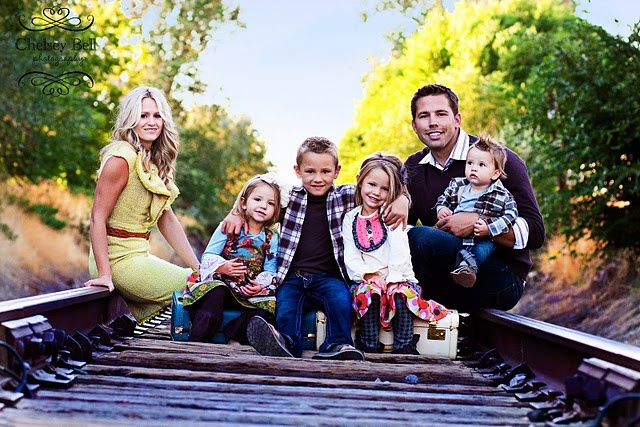 Family Photo. Train tracks. Not super fan of location but cute idea that can be transplanted somewhere a bit more safe.