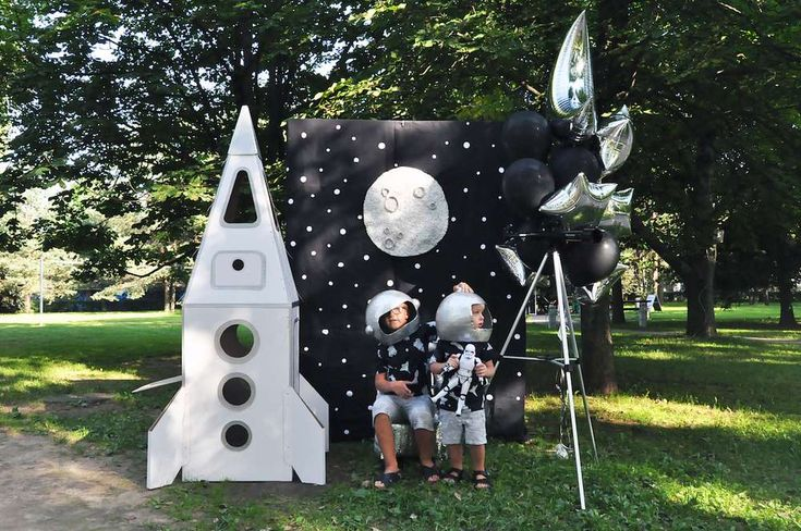 Check out the cool photo booth backdrop and props at this Galaxy Birthday Party! See more party ideas and share yours at CatchMyParty.com #space #photobooth