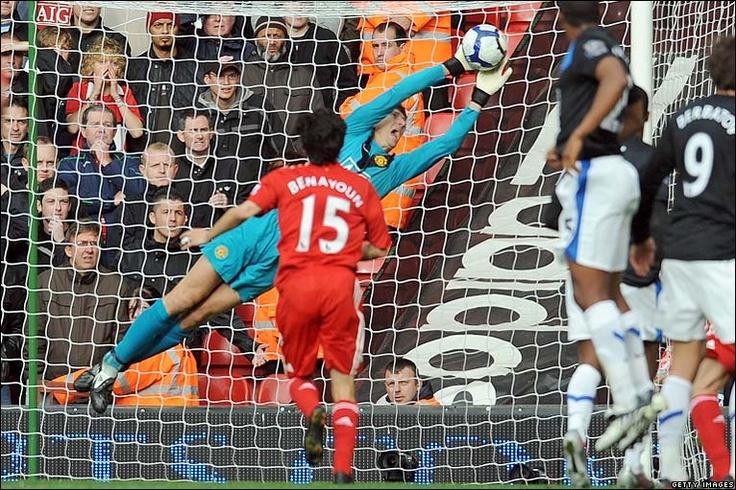 Edwin van der Sar makes a fine save to deny Liverpool's Fabio Aurelio