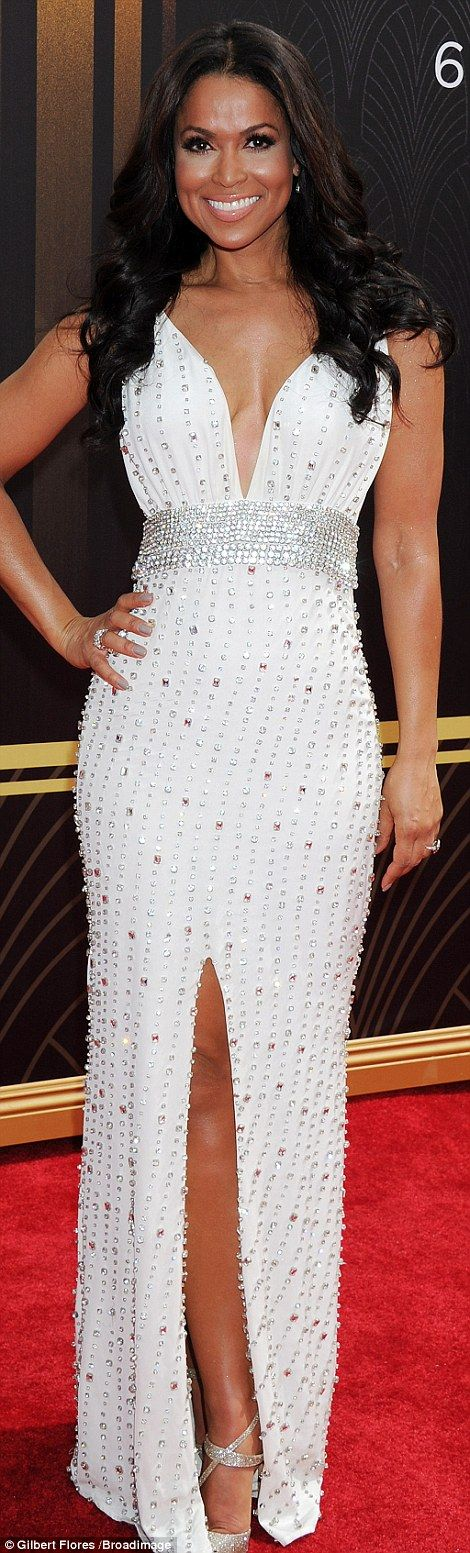 Bit of all white: Extra's Tracey Edmonds stunned in a jeweled white gown with empire waist...