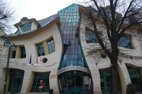 The Crooked House. Located in Sopot, Poland at Bohaterów Monte Cassino Street the Crooked House was constructed in 2003 based off of drawings from  Jan Marcin Szancer and Per Dahlberg.