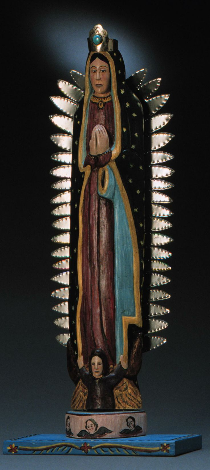 the religious symbol of the virgin of guadalupe On december 9, 1531, in mexico, our lady appeared to juan diego  the  catholic faith  she also had the symbol of the cross at her neck which was the.