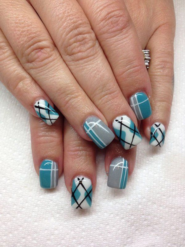 A #cute and quirky looking plaid #nails art #design. The fresh color combination of white, green blue, gray and black colors are visually appealing and simply jump out of the nails.