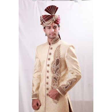Gorgeous Sherwani with exquisite work of golden cora. This charismatic mandarin collar Sherwani comes in square cut styling with cut dana and 24 pp diamond chain. #Sherwani #WeddingCollection #EthnicWear