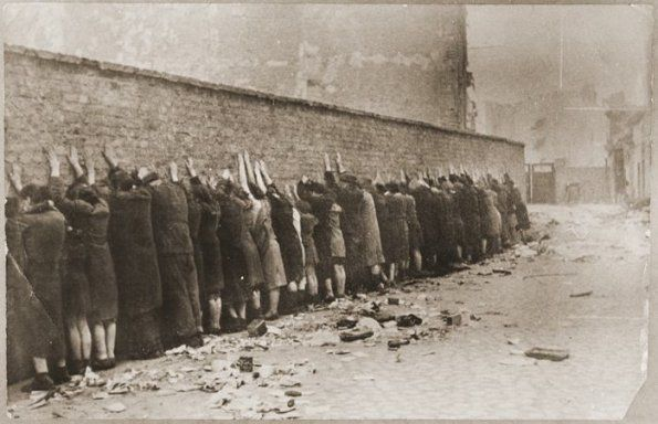 innocent people, lined up, shot / under Hitler