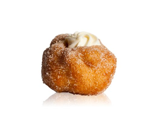 Bigne San Guisepe - A doughnut pastry filled with strega chantilly cream, covered in cinnamon and sugar