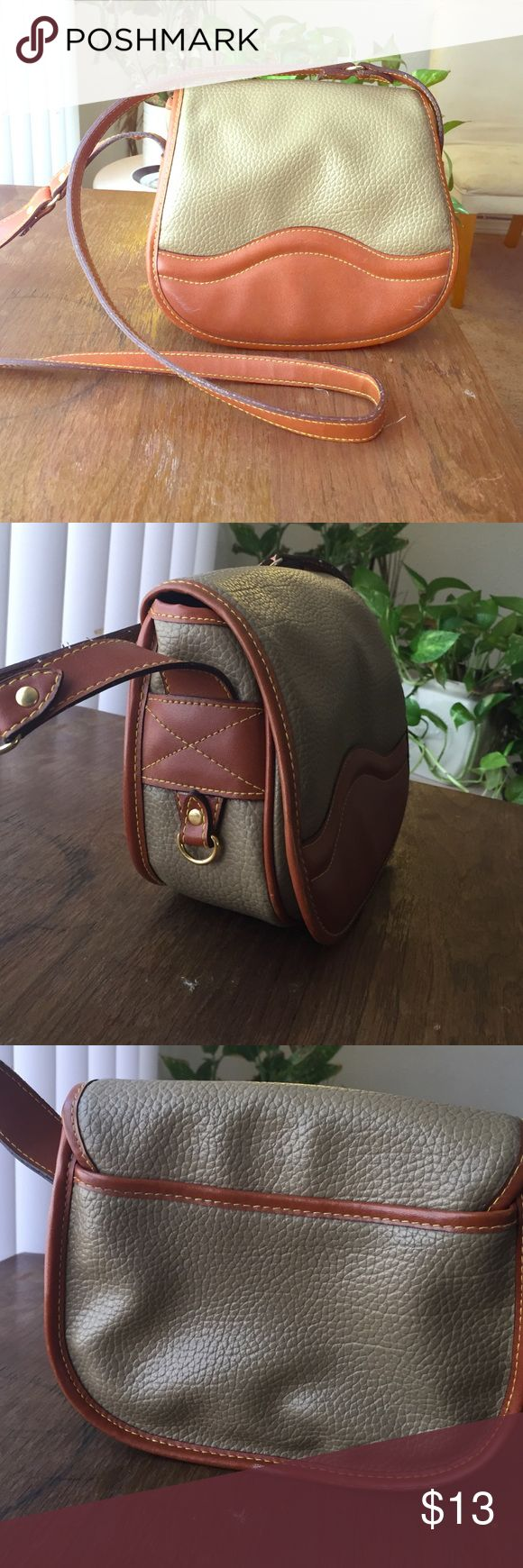 vintage cute cross body very cute and unique vintage crossbodypurse ! its in brand new condition it has been worn but has no signs of it! its very unique it gors with everything ! cute tan and brown colors with long strap to wear crossbody . all the detailing is in a gold color but very little . Bags Crossbody Bags