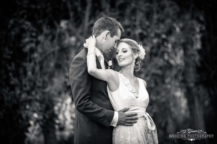 Bride and groom embrace in Black and White wedding photo.   More wedding photography by Anthony Turnham at www.snapweddingphotography.co.nz