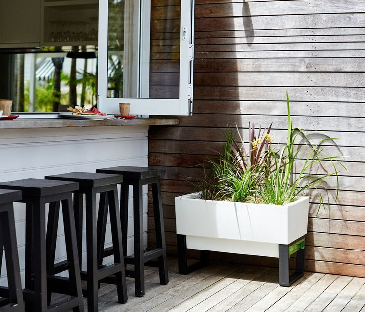 The Glowpear Urban Garden Self-Watering Planter is a modular, self-watering, modern planter with a built-in water reservoir. This planter is specifically designed for growing a wide range of fruits, v