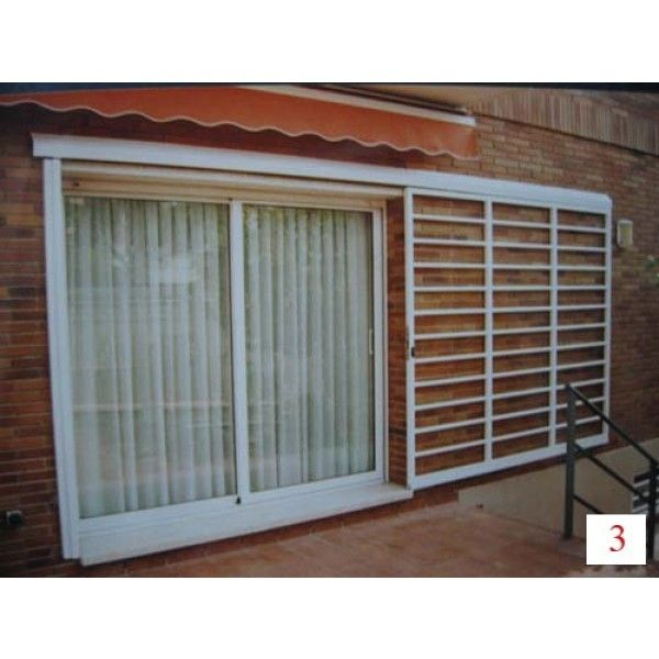 rejas hierro y forja correderas en ventanas de aluminio