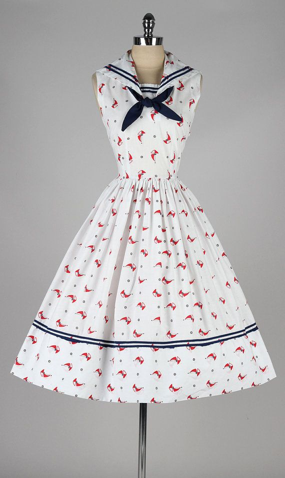 "A sailor collar is a classic touch, as is the white and blue and red color scheme.  Notice the overall ""crisp"" feel to this dress.  Yes, it's a full skirt, which reads feminine - but this is a brisk, efficient feminine."
