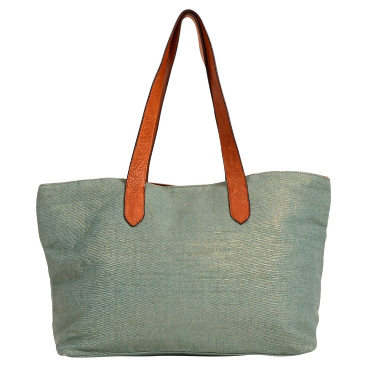 Hand crafted from quality cotton canvas with a delicate gold lurex woven through, finished with super soft leather straps & featuring our signature organiser section. This cleverly crafted style will carry you from work to beach to bar & back again.  Mint sparkle canvas with leather straps. Mint canvas tote with a gold lurex shimmer and genuine leather straps, in our best selling shape with our removable inside lining.
