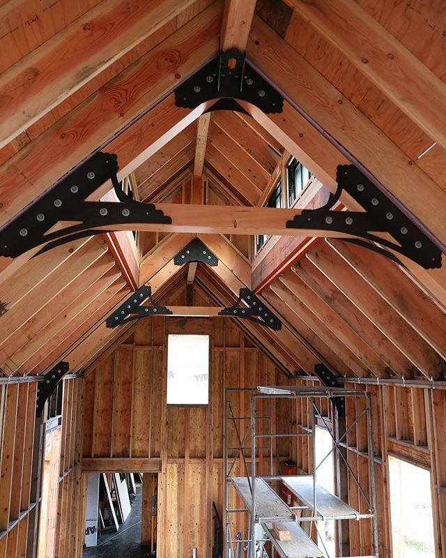 We love the swoopy details in these timber truss brackets