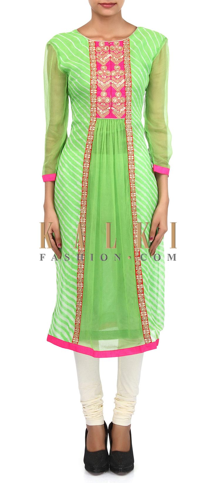 Buy Online from the link below. We ship worldwide (Free Shipping over US$100). Product SKU - 305747.Product Link - http://www.kalkifashion.com/green-and-cream-suit-adorn-in-zari-and-gathers-embroidery-only-on-kalki.html