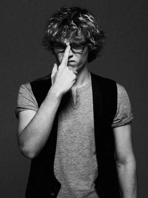Evan Peters. Glasses.