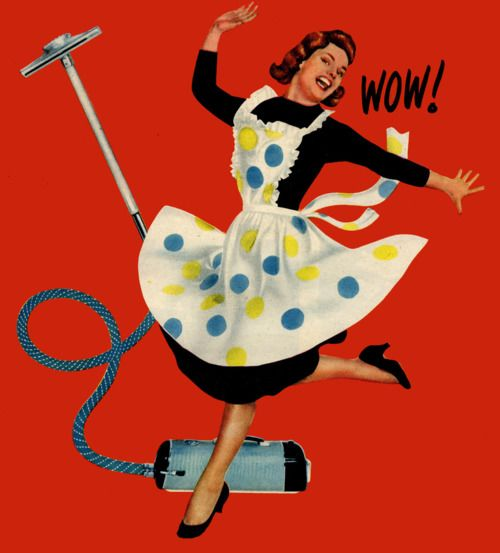 High on housekeeping.  Wow!  Vintage housewife happy dancing over her Hoover / Electrolux vacuum cleaner.