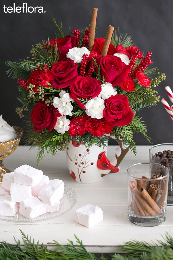 Hand-delivered Christmas flowers in a keepsake holiday mug. #roses #christmas #gifts