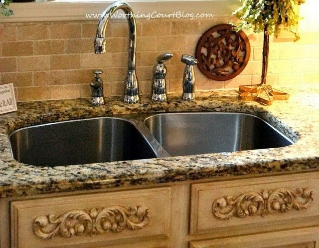 DIY French Country Kitchen Makeover:  appliques were added to faux drawer fronts under the sink