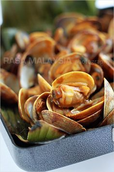 Curry clams wrapped with banana leaves. Curry-flavored clam is a popular Malaysian street food—delicious, spicy, and addictive. Easy curry c...