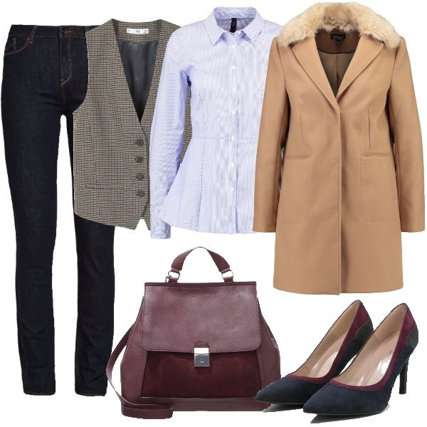Anche un jeans se scuro può essere un'alternativa al completo da ufficio. Qui abbinati a camicia azzurra bastonetto con baschina, gilet principe di Galles, cappotto beige, décolleté in suede a blocchi di colore e borsa a mano bordeaux.