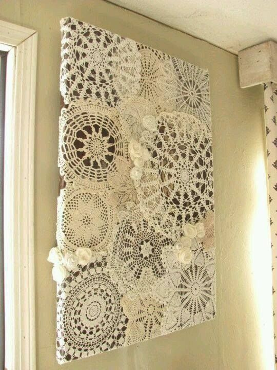 Vintage Doily Wall Hanging made from an old table leaf. The dark wood looks nice showing through the weave of the doilies. But a table leaf is quite heavy! I am sure you can accomplish this with a blank canvas board and just rag on stain or brown paint. https://fbcdn-sphotos-g-a.akamaihd.net/hphotos-ak-xfp1/v/t1.0-9/11008637_10204232740004056_7075646939318285180_n.jpg?oh=b17552a41a7c81b58febdd51ef348522&oe=55C386F1&__gda__=1443581332_c34e8be7c4b0b53993395fcdc4d90525