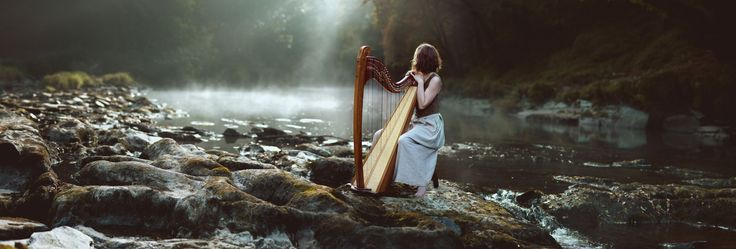 Misty morning music on a Teifi harp at Cenarth falls, West Wales
