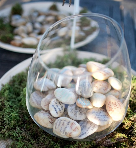 Your quinceanera guests can sign rocks or other small objects that you can display in a vase after your party!