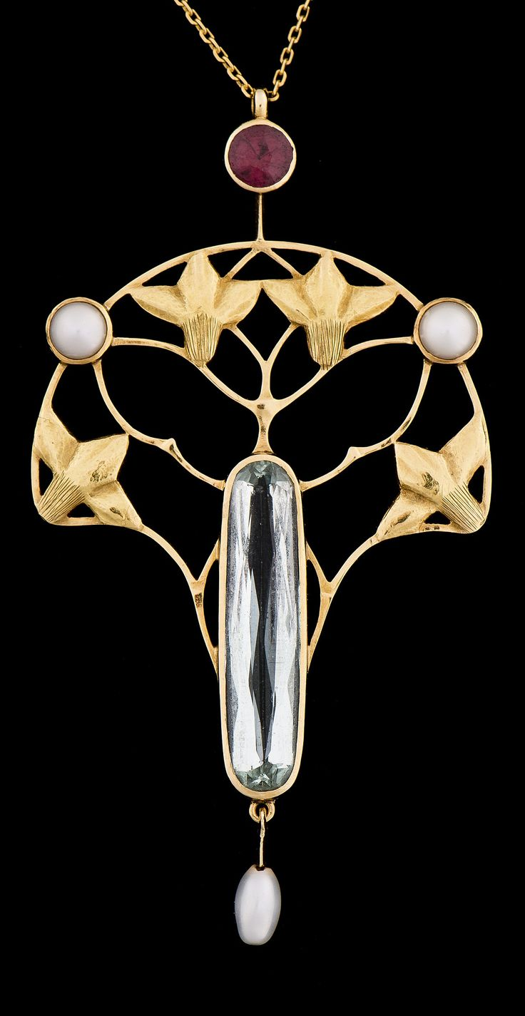 AN ART NOUVEAU PENDANT, CIRCA 1910. Faceted aquamarine, garnet, pearls, 18K gold. Pendant length 6.3cm. #ArtNouveau #pendant