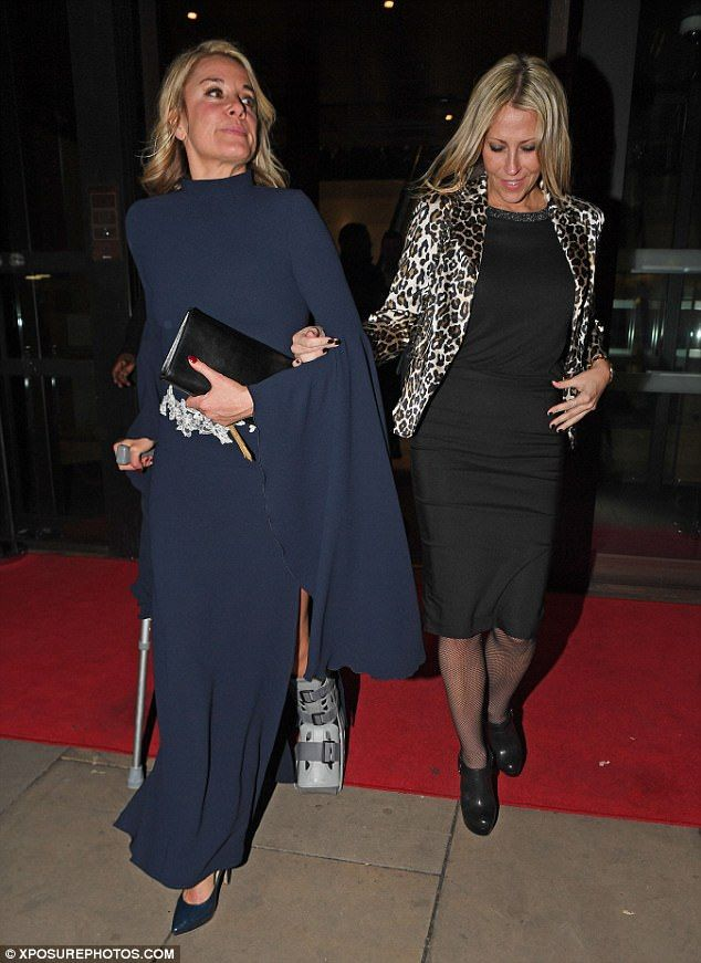 That's gotta hurt! Tamzin Outhwaite struggled along with the help of Nicole Appleton to watch Amanda Holden's show Stepping Out... after a broken ankle forced her to pull out last week