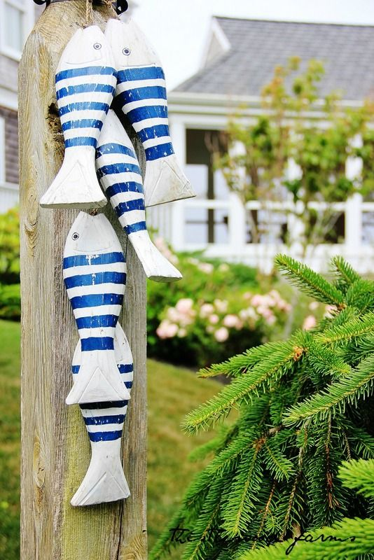 Cape Cod Beach House Tour - Thistlewood Farm. Love the blue and white with the black cabinet behind!
