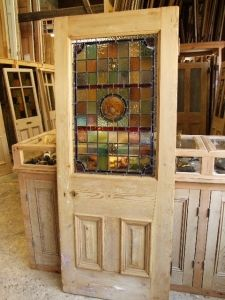 Stained glass, and Victorian pine make the perfect door : )
