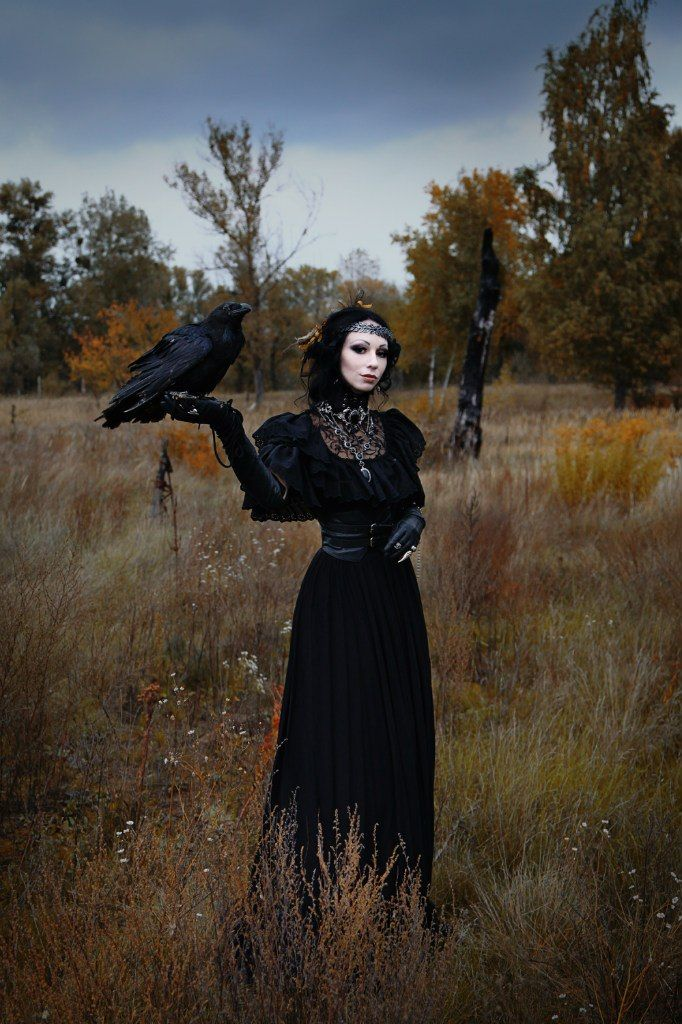Goth girl in Medieval head-wrap and crow