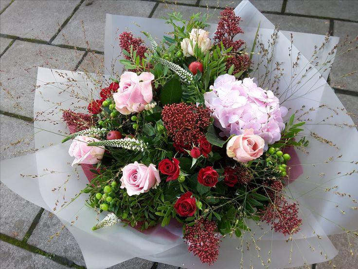 Roses, Veronica, Skimmia, Hydrangea and Berries in a bouquet.
