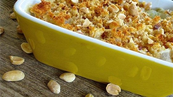 A traditional holiday favorite in my family, this creamed pearl onion recipe is a surprising treat to the palate. Chopped dry roasted peanuts mingle with the cream sauce and onions, while the bread crumb topping gives it a nice bit of added texture. My sister used to bake this at every holiday meal she hosted, and since we've lost her, it has a special meaning :).