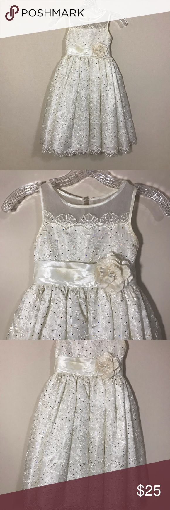 "KLEINFELD GIRLS 6 FLOWER GIRL DRESS KLEINFELD OFF WHITE FLOWER GIRL DRESS SIZE 6. WORN ONCE. STAIN ON BELT AS SHOWN IN PHOTO-YOU CAN JUST REPLACE THE BELT. RHINESTONE AND LACE DESIGN FRONT AND BACK WITH FLOWER AND BELT. PIT TO PIT 11"" LENGTH 32"" 234-E KLEINFELD Dresses Formal"