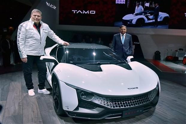 Tata Sons chairman N.Chandrasekaran (right) and Tata Motors CEO Guenter Butschek with the Tamo Racemo at the 2017 Geneva Motor Show on Tuesday. Photo: PTI