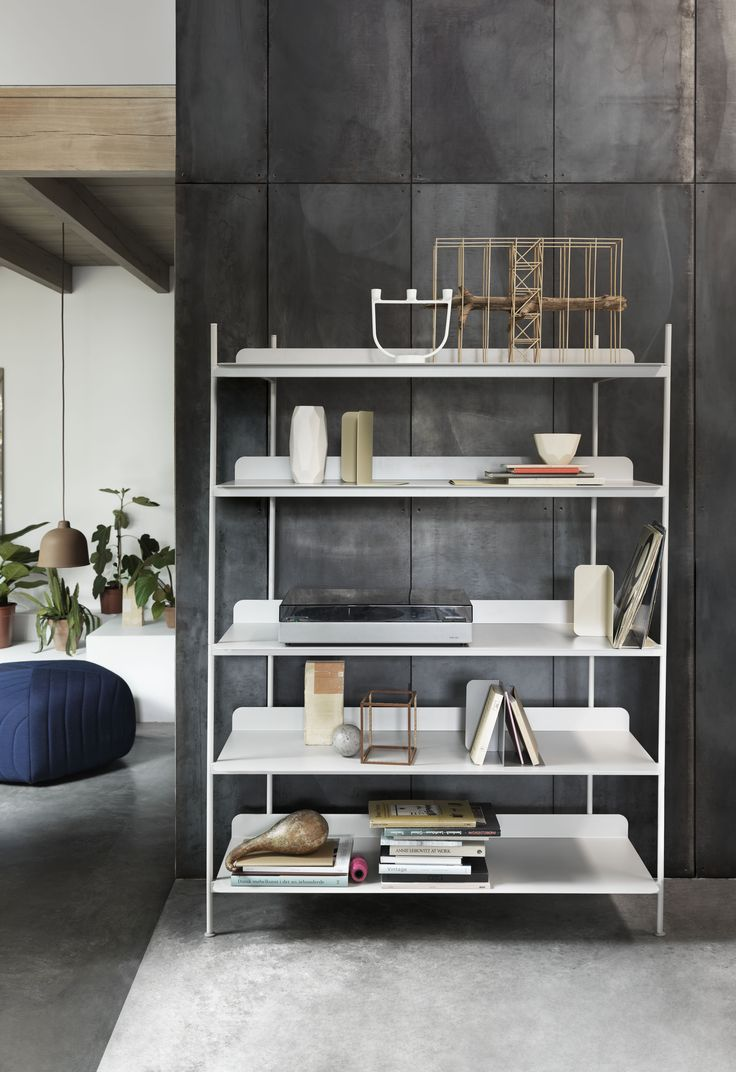a contemporary take on the classic shelving system compile consists of a shelf and three heights of dividing tubes arrange the shelves and tubes as you