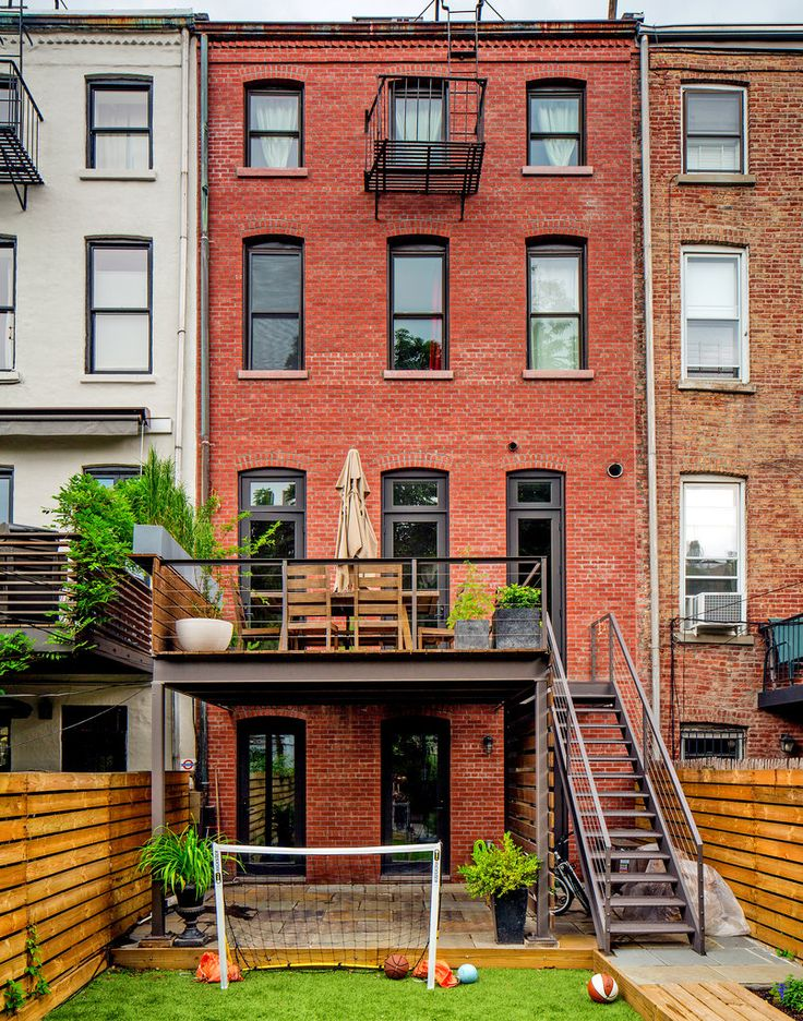 """The backyard is covered with eco-friendly artificial grass. """"Having outdoor space in the city is life-changing,"""" Ms. Davis said. """"Especially with two boys."""""""