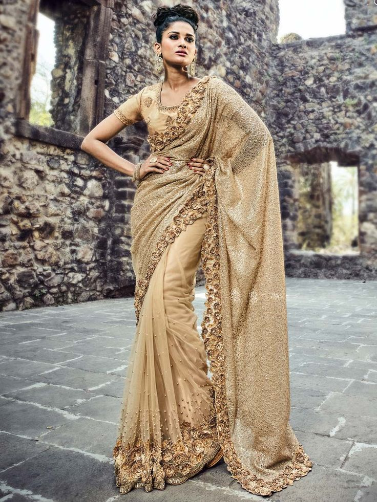 Luxurious beige fancy net saree with embroidered floral design are sure to make you look your best. Look more beautiful and stylish than any body else.