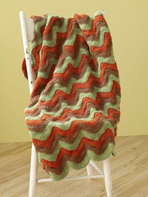 Homage to the 70s -- Ripple Afghan -- free pattern. These are beautiful when done with scrap yarn from your stash, with randomly varied stripes.