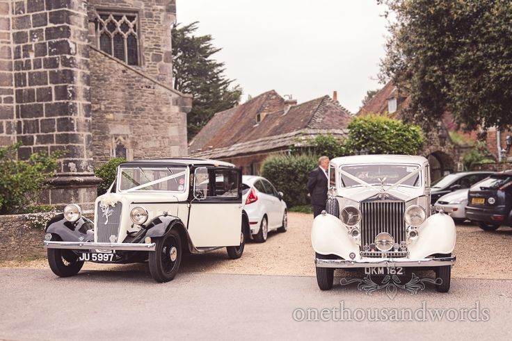 Classic wedding cars outside Wareham church wedding in Dorset. Photography by one thousand words wedding photographers