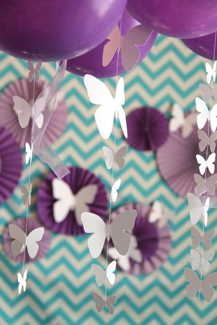white butterflies with pink/purple tissue balls?