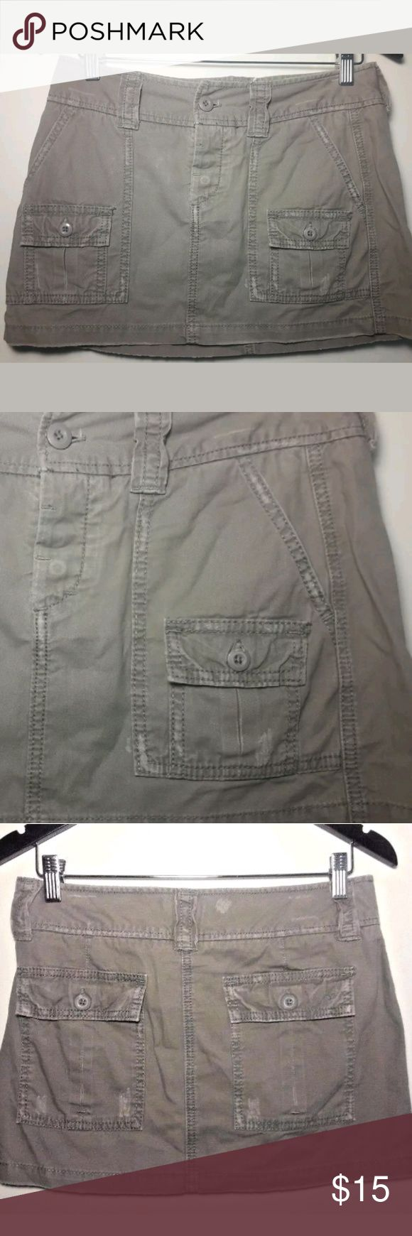 American Eagle Outfitters Cargo Mini Skirt Size 0 American Eagle Outfitters   Gray Distressed Cargo Mini Skirt 100% Cotton. Very cute. Button fly multiple pockets.  Women's Size 0.  Pre-owned in excellent condition. American Eagle Outfitters Skirts Mini