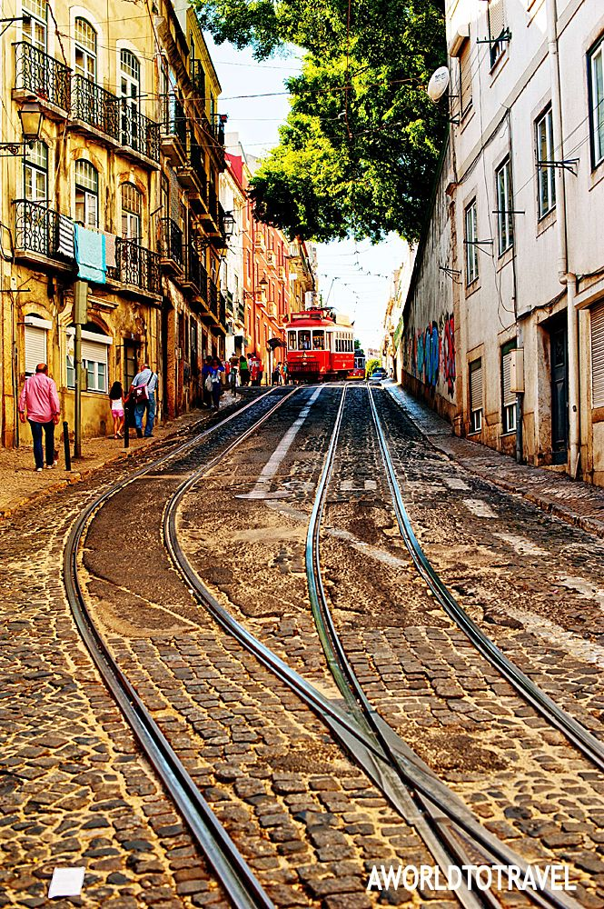 Alfama narrow streets cutted by tramway rails, Lisbon , Portugal @}-,-;—