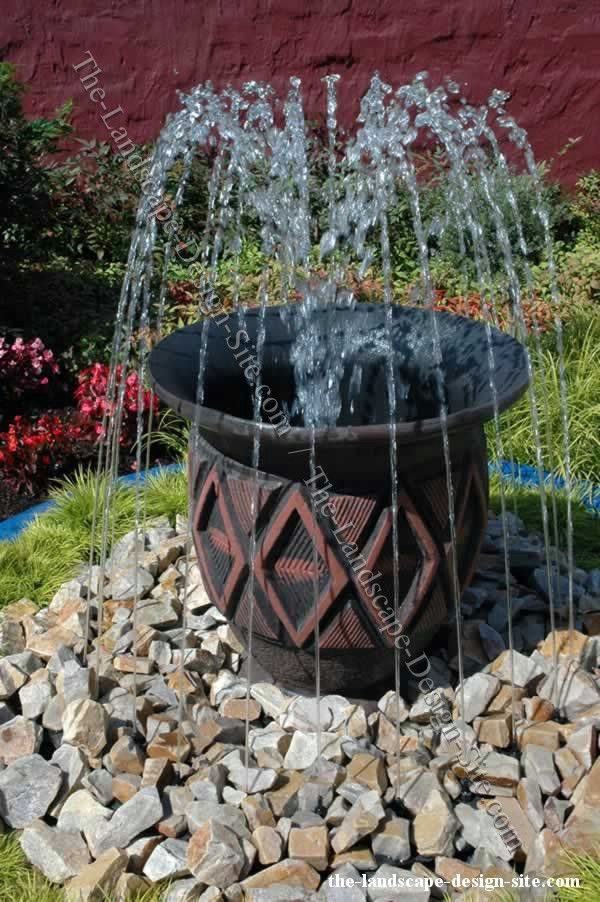25 best ideas about homemade water fountains on pinterest for Garden feature ideas