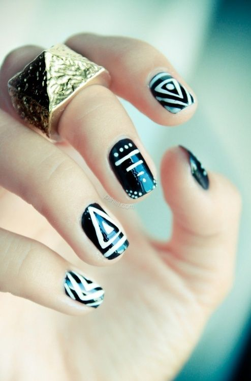 Tribal look. Looks like the nails were first polished black, then a white nail polish pen was used to draw the lines. You can get these from sallys