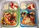 In our lunch boxes: Veggie pizza, a little tuna salad, fruit, & nuts and raisins make for an eclectic lunch.